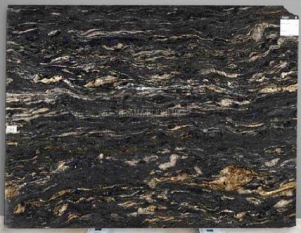 shot of smooth black cosmic stone from grama blend uk