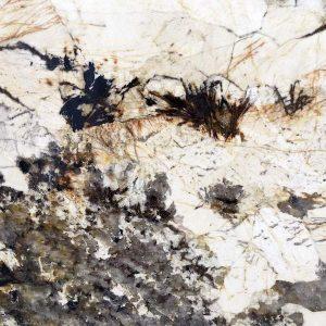close up shot of polished patagonia granite from grama blend uk